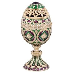 Over-the-top ornamentation characterizes this jeweler-style, museum-quality enameled egg first made famous by Carl Faberg in the 17th century. The Minishka boasts an intricate filigree of emerald and