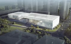 This glass-covered design  for the Shenzhen Art Museum and Library complex in China beat proposals from a number of star architects. Read the full story on dezeen.com