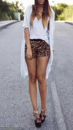 leopard printed short, ankle strap wedges, and long sweater. Love!