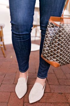 Lifestyle blogger Samantha Bigley of The Heart of the House wearing a ASOS lilac ruffle sweater, frame denim and suede mules