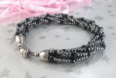 Hematite Black Onyx Bracelet Multistrand Sterling Silver. I need some of those magnetic clasps.