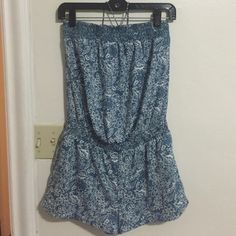 American Eagle Outfitters: Strapless Romper American Eagle Outfitters blue and white strapless romper. Has string which you can wear halter style or just tied as a bow. Size small but fits small/medium. Has 2 front pockets and 2 back pockets with elastic cinching waist. American Eagle Outfitters Other