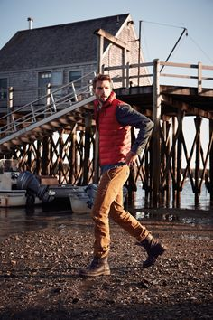 Rafael Lazzini: Red puffer vest worn with denim shirt, corduroys and boots. Colder weather style for men.