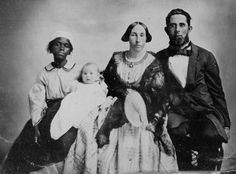 Slaveholder and family with their one Slave.  (Photo: From the Blue Ridge Mountains.)