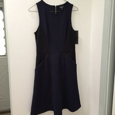 HPNavy Fit and Flare Dress w/ Pockets NWT! Gorgeous brand new with tags fit and flare navy dress from Target! Bought for my cousins wedding as a back up but instead am wearing a dress from a fellow posher love the cut and color but it's a little big on me and I had planned to have it tailored - true to size for a small! Mossimo Supply Co Dresses