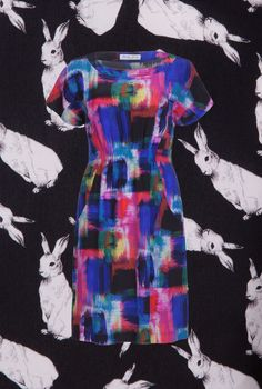 Marilyn Moore AW13 Silk NOA dress in Rainbow patches with Marilyn Moore rabbits print background. #Marilynmoore #BritishDesign