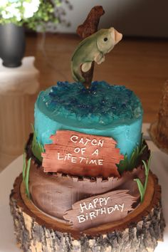 Chocolate groom's cake with gumpaste jumping fish.