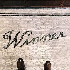 tile type lettering Winner