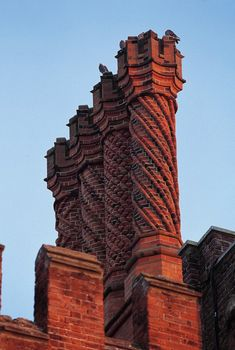 The famous Tudor 'Swizzle Stick' chimney pots stand out on the rooftops of Hampton Court Palace.