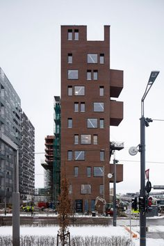 Red-brick boxes pop out of A-Lab's narrow office block on Oslo waterfront Futuristic Architecture, Facade Architecture, Brick Building, Building Design, Norway Oslo, Scandinavian Architecture, Arch House, Flatiron Building, Pop Out