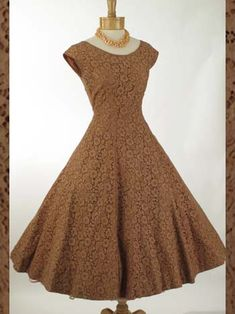 Oh, how I love mocha dresses!  Good thing this one is out of stock!