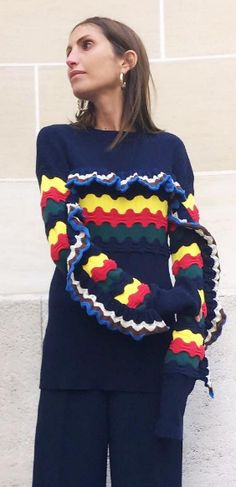 Shop now. Marni just raised the knitwear bar. The indispensable navy cotton-blend sweater is emboldened for the new season decorated with a colourful crochet panel and bordered with a frill that slinks its way across the chest and onto the arms. We'll be wearing ours with loose-fit denim and backless loafers.