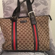 Gucci tote bag Brown/tan/red/green authentic Gucci tote bag, used, minor damage can be taken to a cleaners if necessary Gucci Bags Totes