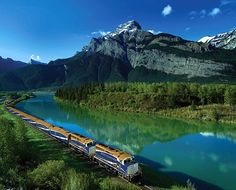 Rocky Mountaineer Train through the Canadian Rockies - take in panoramic views of snow capped mountains, Fraser Canyon, and the Thompson River on your way from Vancouver, B.C. To Banff, Alberta. Onboard meals emphasize regional dishes such as wild B.C. sockeye salmon with fennel slaw.