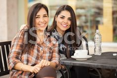 Best friends having coffee together at a restaurant royalty-free stock photo