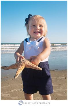 What a beach memory for this little girl in navy and white!