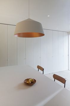 Jonathan Tuckey, Submariner's House, White Kitchen, White Copper Lined Pendant Lamp, London | Remodelista