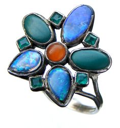 Sibyl Dunlop. An Arts and Crafts ring. Silver, opal doublet, cornelian and chalcedony.