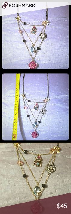 Betsey Johnson Gold color change with spider , floral,  and spider Web designs.  In good condition  worn twice. Betsey Johnson Jewelry Necklaces
