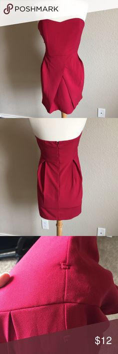 Red Strapless Dress (43) Red hot strapless dress in a thick structured fabric and layered skirt. Only flaw is the belt straps which have been cut off. Tag size large. Bust- 16.5 Waist- 15 inches Length- 27 inches Forever 21 Dresses Strapless