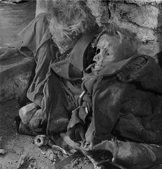 The charred bodies of two German civilians who were killed in an Allied aerial raid during the Bombing of Dresden are unearthed from an air raid shelter shortly after the end of the war. In four raids between 13 and 15 February 1945, 722 heavy bombers of the British Royal Air Force (RAF) and 527 of the United States Army Air Forces (USAAF) dropped more than 3,900 tons of high-explosive bombs and incendiary devices on the Dresden. The bombing and the resulting firestorm destroyed over 1,600…