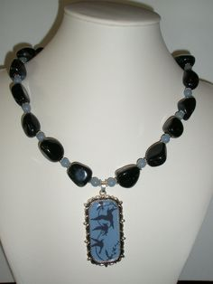 Unique necklace with birds pendant ,Black Agate nuggets and Blue Angelite. Necklace is long, plus 2 pendant drop. Earrings are 1 long with Blue Angelite and lever back ear wire. Rustic Wedding Jewelry, Beaded Necklace, Pendant Necklace, Holiday Jewelry, Black Agate, Unique Necklaces, Bracelet Patterns, Diy Jewelry, Bird