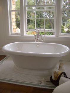 Love the tiles around the tub (wood look tile with white mosaic rug effect) Cabin Bathrooms, Bathroom Spa, Master Bathroom, Remodel Bathroom, Bathroom Ideas, Tile Around Tub, Stand Alone Bathtubs, Black Bathtub, Master Suite Bedroom