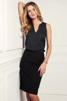 Black pencil skirt with either black or white sleeveless shirt