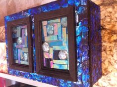 Jewelry box covered with shades of blue eggshell mosaics and glass...