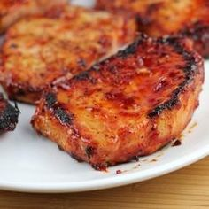 Honey Garlic Pork Chops Recipe Ingredients: 1 cup ketchup cup honey ¼ cup soy sauce 2 garlic cloves (minced) 1 boneless pork chops 4 oz portions) salt and pepper Cooking Instructions: Step In a medium bowl stir together ketchup, honey, so Pork Chop Recipes, Grilling Recipes, Meat Recipes, Cooking Recipes, Healthy Recipes, Cooking Chef, Online Recipes, Delicious Recipes, Free Recipes