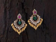 Uncut diamond pacchi setting, chandbalis with ruby n emaralds