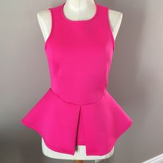 Hot pink peplum top Stretchy, zippers up the back Tops Blouses