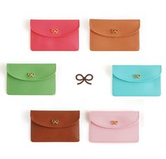Gold ribbon business card cases.