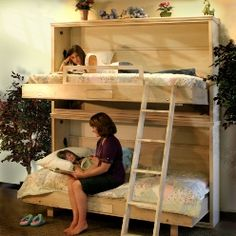 Folding bunk beds. LOVE this idea... wish I needed them : ) ummm would be a great way to make your bed and get it out of the way...maybe I COULD use it ... LOL ~!~