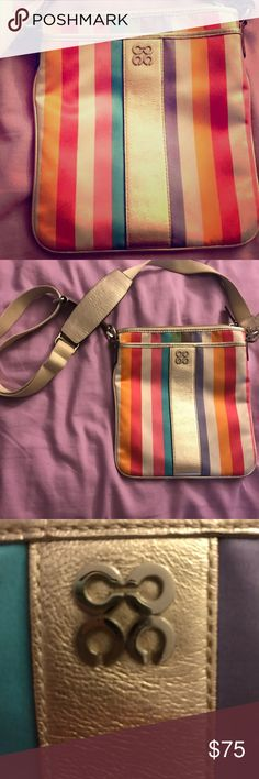 Authentic Coach Purse Fun summer striped purse with a cross body strap. Perfect size for shopping, concerts, or running around. Gold adjustable strap. Zippered big and small pocket. Silky soft material. Coach Bags Crossbody Bags