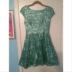Fully sequined skater style homecoming dress. Fully sequined dress with skater style bottom. Lining is 100% polyester and very comfortable. Has low cut back and cap sleeves. Size runs true. Only worn for a few hours. Great for homecomings! B. Darlin Dresses