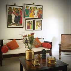 Another view of my uncle and aunt's living room in their Bengaluru home. Thota Vaikuntam paintings recreated by my uber talented cousin, add the required punch of color to the space. Diwan style seating and a vintage planters chair is the perfect definition of comfort seating. A few selected brass artifacts and fresh flowers on the coffee table are in sync with the sophisticated yet simple decor style that prevails in the living room. And a very happy Sunday folks!!! (:Sruthi Singh)…