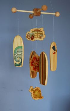 For the Hawaii lover in me...    Surfboard Baby Mobile - Woody Surf Boards and Car - Surf or Beach Baby Nursery. $75.00, via Etsy.