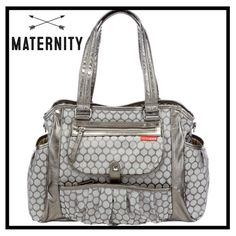 """STUDIO Diaper Tote Features * 16.5"""" wide * Quilted cushioned changing pad * 14 pockets ; zip-top closure  * Water-resistant inside and out * Snap-down front pocket lets you stash a blanket/bib underneath * Nickel feet keep STUDIO off the ground and scuff-free * Hangs neatly on a stroller and can be worn over the shoulder and contrasting lining makes it easy to find what you need.                                  LIKE NEW USED A FEW TIMES. NEVER USED CHANGING PAD. CLEAN  17 x 6 x 12 inches…"""