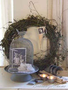 Cloche made from old wire.  Like the photo displayed inside and the wreath behind it.