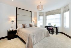 The master bedroom features luxury bespoke furniture, and the new underfloor heating and air conditioning systems throughout ensure a comfortable environment