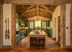 This breathtaking kitchen from Home on the Range Interiors rocks green kitchen cabinets. The key to pulling off green cabinets is letting them take center stage, and using simple decor and a neutral color scheme to make them pop. Homey Kitchen, Rustic Kitchen Design, Western Kitchen Decor, Kitchen Remodel, Green Kitchen Cabinets, Rustic Kitchen, Kitchen Design, Rustic Ceiling, Rustic House