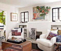 Casual, eclectic and cozy. This room has the window frames painted out black...one of my favorite design details!