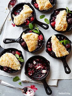 southernliving:  Almost too cute to eat. Almost. Mini Berry Cobblers