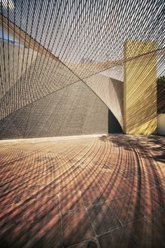 """Eco Pavilion"": Extending the play of angles and light that are one the hallmarks of the Museo Experimental Eco (by artist Matthias Goeritz, 1953), this award-winning temporary pavilion uses parallel lines of rope to define a parabolic ""roof"" above the central courtyard. 