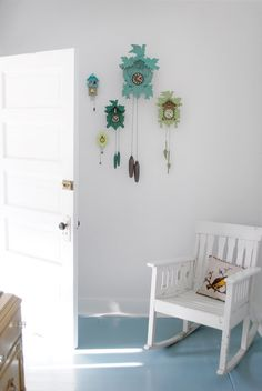 15 Unexpected Ways to Decorate with Collections: This homeowner used cuckoo clocks painted in blues and greens to compliment her son's summer camp themed nursery.
