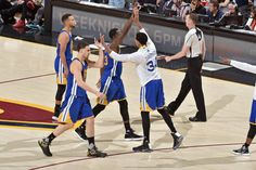 The Golden State Warriors high five against the Cleveland Cavaliers in Game Three of the 2017 NBA Finals on June 7 2017 at Quicken Loans Arena in...