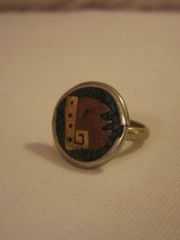 $39 Vintage Alpaca Silver Ring Mayan Warrior King inlay Turquoise chips, Copper & Bra at https://shopsto.re/items/2156 #accessories #jewelry #rings