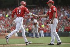 Cincinnati Reds' Joey Votto (19) rounds the bases after hitting a home run to drive in Billy Hamilton as Washington Nationals starting pitcher Gio Gonzalez, center background, walks back to the mound in the third inning of a baseball game, Saturday, May 30, 2015, in Cincinnati.   -   © AP Photo/John Minchillo