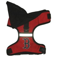 Show your passion for the Boston Red Sox as your dog sports this officially licensed Pets First Major League Baseball hooded harness in vibrant team colors. This padded harness features an embroidered team logo on the back and a reflector stripe for safety. The sport hooded harness is made out of lightweight, soft twill material and flexible padded air mesh to allow air to flow through so your dog stays cool.